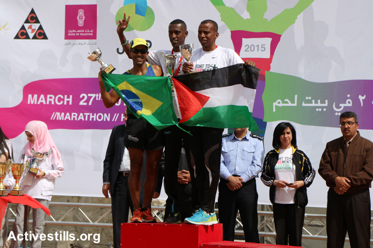 Brazilian and Palestinian winners celebrate following the third annual Palestine Marathon, March 27, 2015.