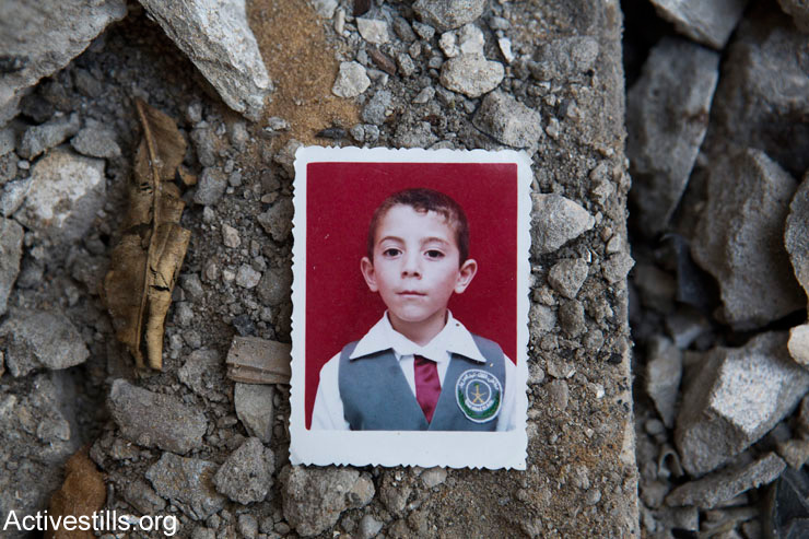 A photo of Abdallah Abdel Hadi Al Majdalawi amid the ruins of his home, Gaza Strip, March 19, 2015. Abdallah (13) was killed alongside his brother Abdelrazek (19) and his cousins Rawan (9) and Mahmoud (8), by an Israeli attack which took place without any warning on August 3, 2014. The attack also destroyed the adjacent home of Ahmed Al Majdalawi.