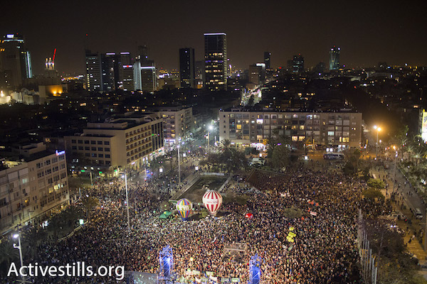 Tens of thousands of people at a demonstration calling to replace Netanyahu as Israel's prime minister, Rabin Square, Tel Aviv, March 7, 2015. (Photo by Oren Ziv/Activestills.org)