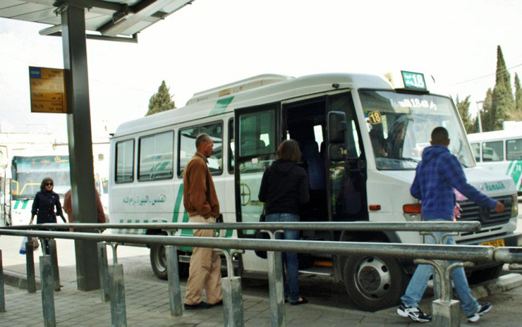 Passengers board a bus to Ramallah at the Palestinian bus station in East Jerusalem. (Photo: Anthony Baratier/CC)