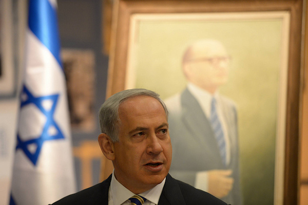 Prime Minister Benjamin Netanyahu in front of a painting of former Likud prime minister Menachim Begin. (Photo: Amos Ben Gershom/GPO)