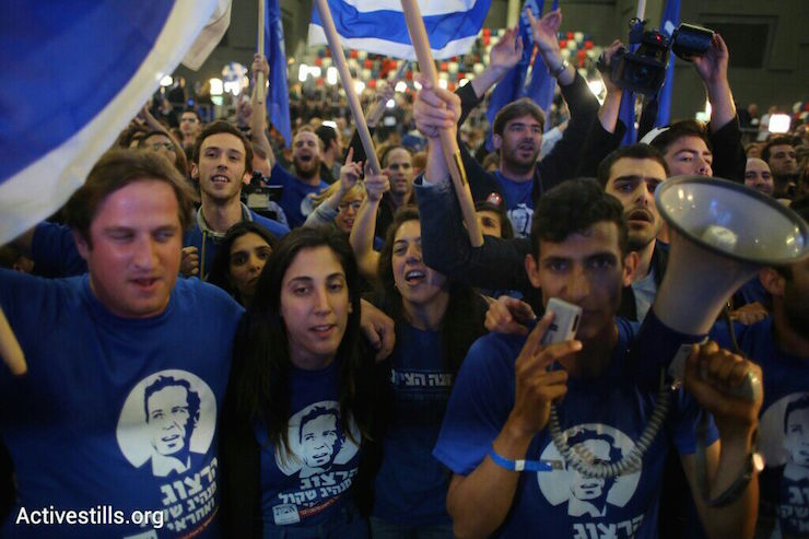 Supporters of the Zionist Camp celebrate as exit polls results are published, Tel Aviv, March 17, 2015. (photo: Yotam Ronen/Activestills.org)