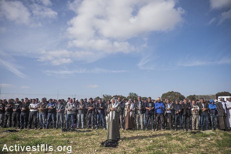 Thousands participate in the funeral of Zana Abu Trash, Mnua Abu Elkian, Fatma Abu Elkian, Kfaia Alasibi and Name Abusheida near the Bedouin town of Hura, Negev, February 4, 2015. Eight women were killed in a car accident yesterday on their way back from a prayer in Jerusalem. A truck of the Israeli Land Administration, returning from destroying Bedouin crop, crushedinto a bus killing eight and injuring dozens. Road 31 serves primarily the bedouin communities of the Negev, and is the only rout to the city of Arad. Over 70 people were killed on it in the last decade due to poor infrastructure.