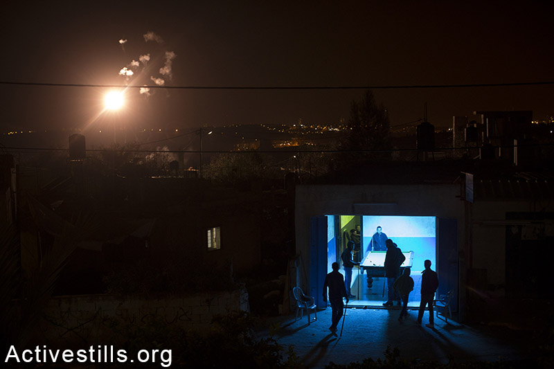 Palestinian youth play pool in the West Bank village of Bil'in, February 9, 2015. Oren Ziv / Activestills.org