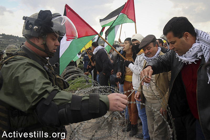 The Palestinian activist Abdullah Abu Rahme joins local villagers at a protest against the closing of the eastern gate to the West Bank village of Azzun, february 14, 2015. The gate, which has been closed since 1990 due to requests by the nearby illegal settlement of Karnei Shonron, previously served as a crossing into the city of Nablus. Ahmad al-Bazz / Activestills.org