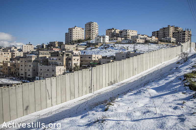 The Separation Wall and the Sh'uafat Refugee Camp are seen following a snow storm, on February 20, 2015. Yotam Ronen / Activestills.org