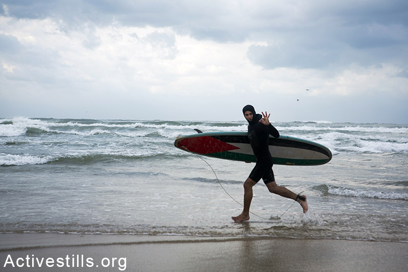 A  group of Palestinian surfers on the coast of Gaza city, February 13, 2015. The sea remains one of the few open space where Palestinians can go and try to relax despite a very dire humanitarian situation and the trauma following the last summer Israeli military offensive. Basel Yazouri / Activestills.org