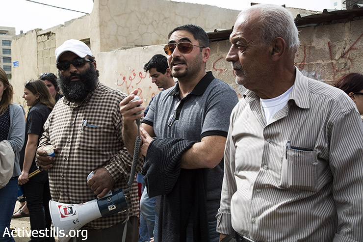 Members of the Shamasneh family speak during a protest against the Judaization of Sheikh Jarrah, East Jerusalem, March 27, 2015. (photo: Mareike Lauken, Keren Manor/Activestills.org)
