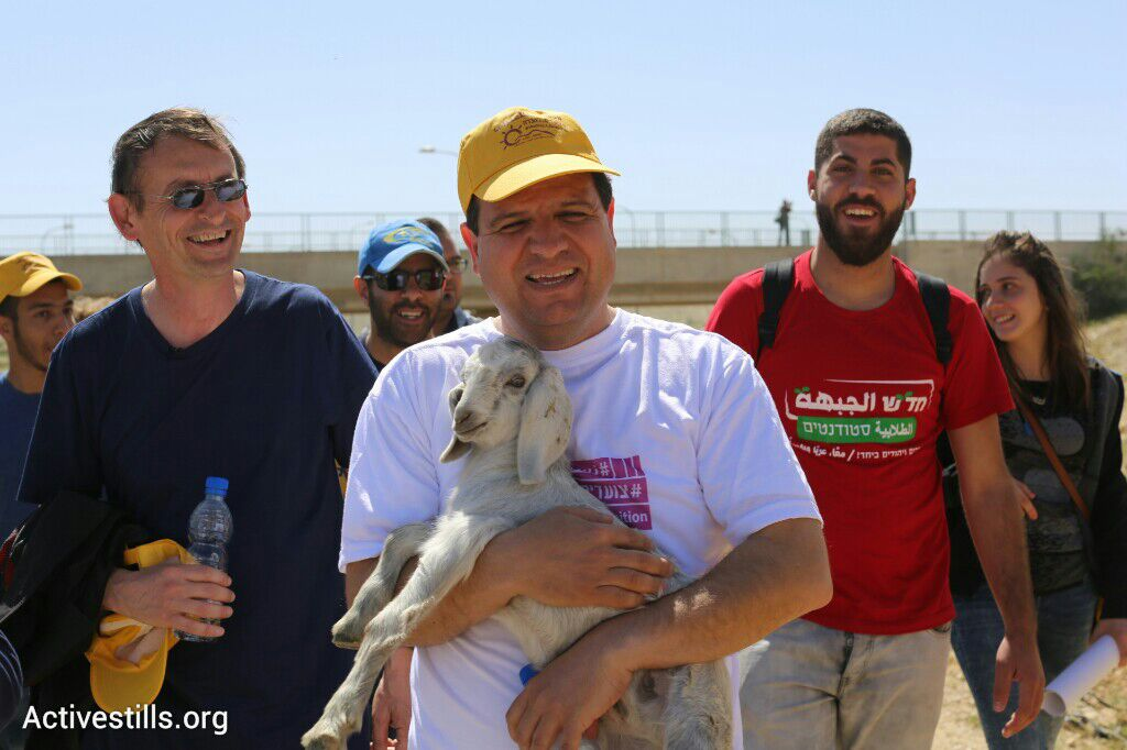Joint List head Ayman Odeh (center) and MK Dov Khenin (left) march during a four-day journey across unrecognized Bedouin villages in the Negev, March 26, 2015. (photo: Oren Ziv/Activestills.org)