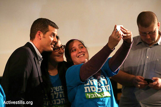 Jewish Home supporters take a selfie with candidate Ronen Shoval. (Activestills.org)