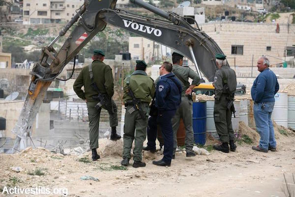 Israeli police oversee the demolition of a Palestinian home in the East Jerusalem neighborhood of Silwan. Settler organizations Elad and others have worked to take over and demolish Palestinian homes in order to move Jewish families in. (File photo: Keren Manor/Activestills.org)