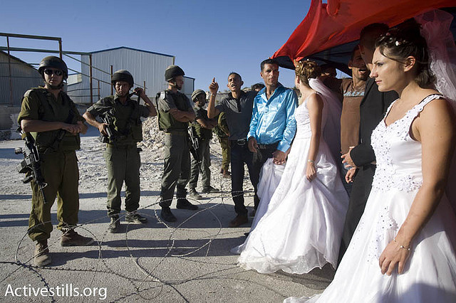 Palestinian demonstrators hold a mock wedding during a nonviolent demonstration in the West Bank village Al-Ma'asara. (photo: Oren Ziv/Activestills.org)