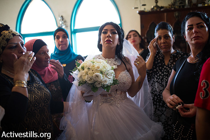 Moral Malcha, 23, seen as her husband arrives at his family house in Jaffa, Israel, on 17 August 2014, before their wedding celebration. Moral was born Jewish and converted to Islam in order to marry Mahmoud. Their wedding was protested by the ultra-nationalists organization Lehava.