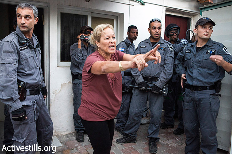 Police raid the house and evict the Halif family in Givat Amal neighborhood, Tel Aviv, September 17, 2014. Residents and community activists gathered in the neighborhood in an attempt to stop the eviction. The residents, who were placed there by the state in the 1950s, have been leading a struggle to recognize their rights to the property, which were sold to an Israeli businessman in the 1970s. More families in the neighborhood are under a threat of eviction.