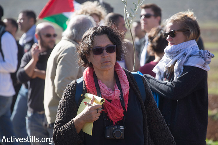 Reporter Amira Hass is seen during a protest marking International Human Rights Day in the village of Turmus Ayya near Ramallah, West Bank, December 10, 2014. Ziad Abu Ein, the Palestinian Authority Minister of Israeli Settlements and the Separation Wall, died after being beaten by Israeli forces during the protest.