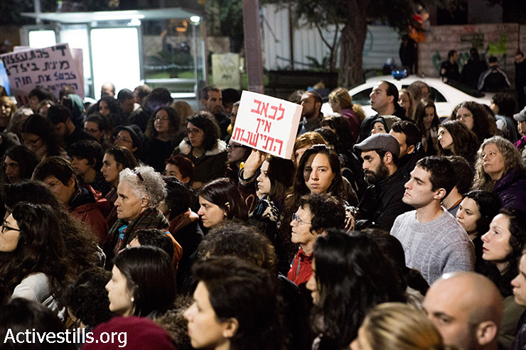 """A woman holds sign reading: """"Suffering doesn't have a statute of limitations"""" during a memorial event for Maya-Gaya (Vered) Lev, Tel Aviv, Israel, December 21, 2014. After years of struggling with the Israeli legal system in her case against her father and brother for sexually abuse, and in front of her mother who kept silent, Lev committed suicide on November 30, 2014.  Some 300 people gathered in memory of Maya-Gaya and called for the re-opening of her case which was closed by the Israeli Authorities."""