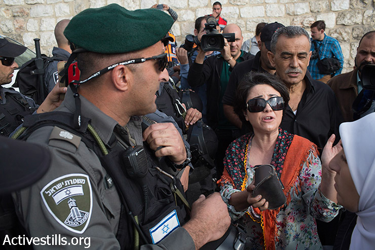 MK Hanin Zuabi argues with Israeli policemen as she tries to enter Al Aqsa Mosque during a protest outside Jerusalem's Old City against Israeli authorities' policy to limit access for Muslim worshippers, October 15, 2014. At least four protesters were arrested after Israeli police dispersed the protest. Muslim men and women over 50 are allowed to enter the compound in recent weeks, as Jewish right-wing activists enter Al Aqsa Mosque compound with police escort.