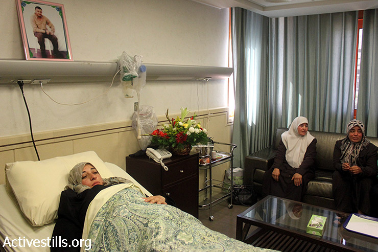 The wife of Abdel-Fatah shalabi, a Palestinian who is imprisoned in Israeli, lies in a hospital bed a few hours before childbirth, Nablus, West Bank, April 2, 2014. The wife delivered a baby conceived through artificial insemination after her husband's sperm was smuggled from an Israeli prison. Shalabi was arrested in 2003. He was sentenced to 20 years in Israeli prison.