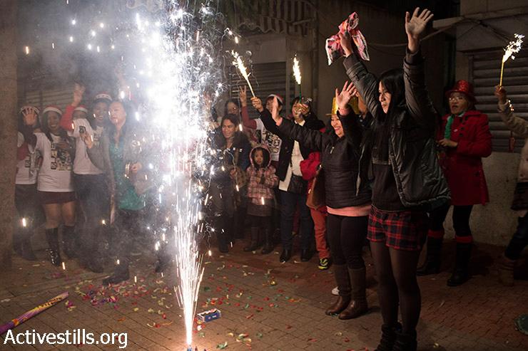 Filipino migrant workers celebrate New Year's Eve in Tel Aviv's southern neighborhood of Neve-Sha'ana, January 1, 2014.