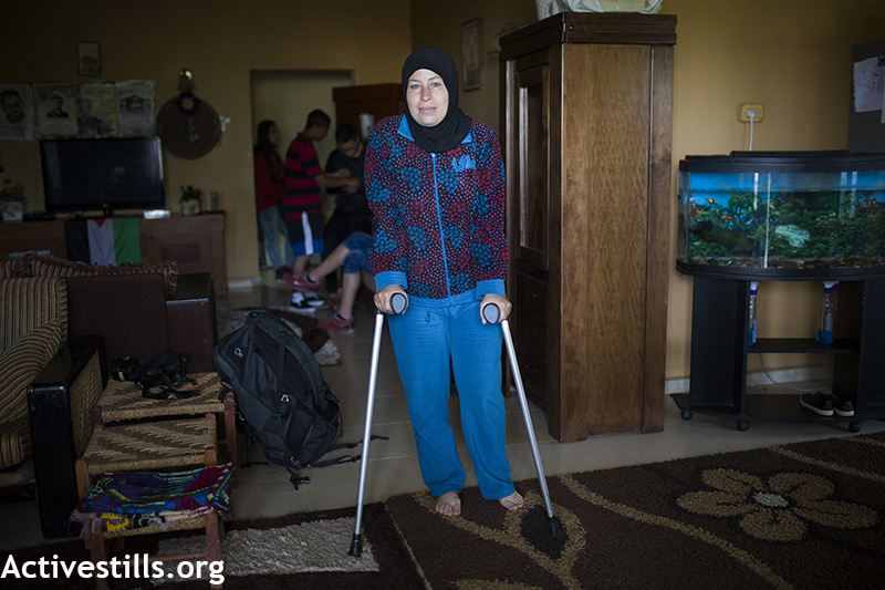 Nariman Tamimi seen recovering in her home, four months after she was shot with life ammunition by Israeli forces during the weekly protest against the occupation, Nabi Saleh, West Bank, April 3, 2015. Nariman was shot on Friday November 22, 2014. Anne Paq / Activestills.org