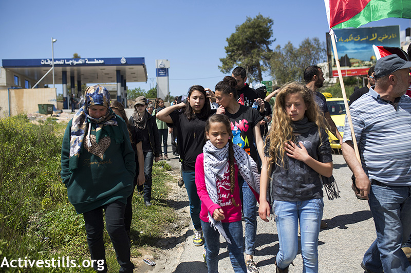 Manal Tamimi marching with other protesters, a few seconds after she was hit, during the weekly protest against the occupation, Nabi Saleh, West Bank, April 3, 2015. Anne Paq / Activestills.org