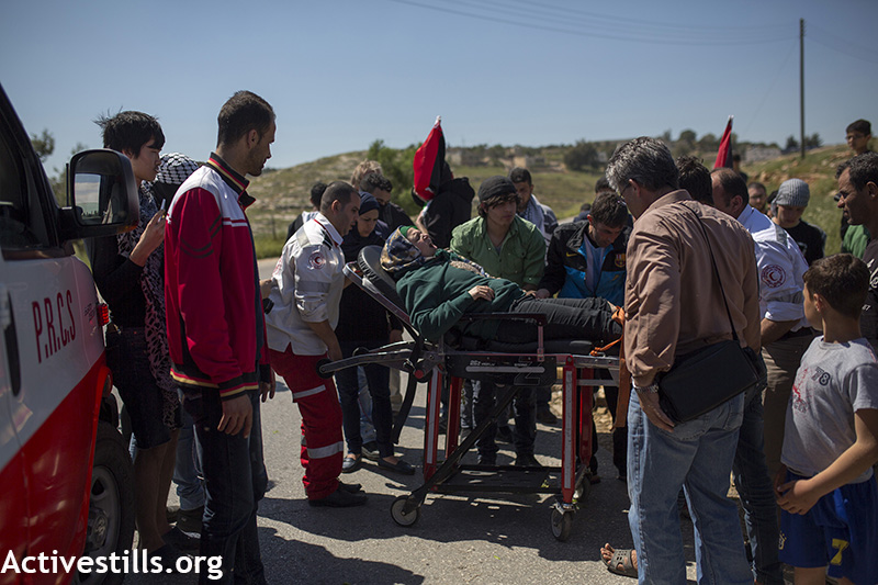 Manal Tamimi being evacuated to the hospital during the weekly protest against the occupation, Nabi Saleh, West Bank, April 3, 2015. Anne Paq / Activestills.org