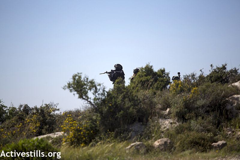 Israeli soldiers shooting at protesters during the weekly protest against the occupation, Nabi Saleh, West Bank, April 3, 2015. Anne Paq / Activestills.org