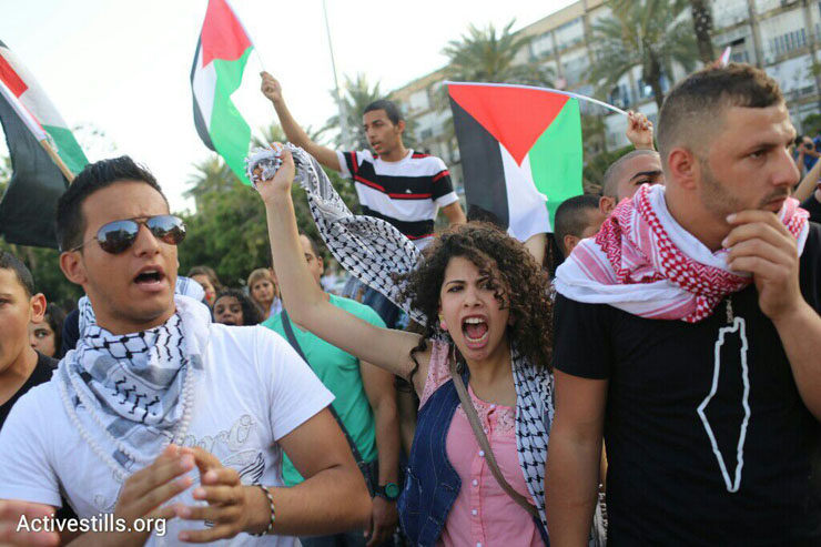 Thousands of Palestinian citizens of Israel demonstrate against the government's housing discrimination and policy of home demolitions, Rabin Square, Tel Aviv, April 28, 2015. (Oren Ziv/Activestills.org)