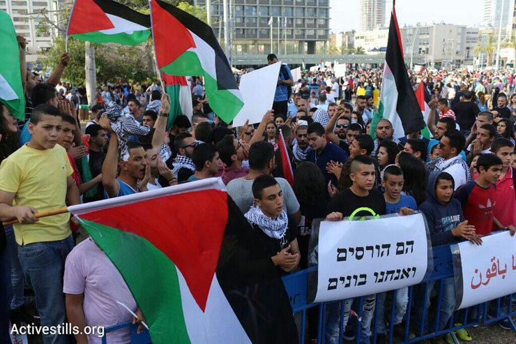 Palestinian citizens of Israel demonstrate against the government's housing discrimination and policy of home demolitions, Rabin Square, Tel Aviv, April 28, 2015. (Oren Ziv/Activestills.org)