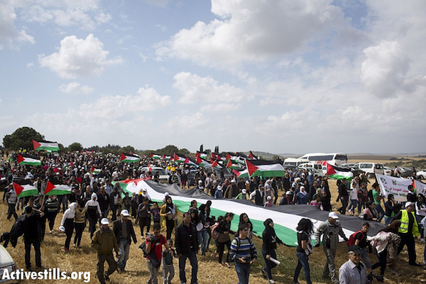 Approximately 10,000 people take part in the annual 'March of Return' to the demolished Palestinian village of Khubayza in northern Israel. Although Nakba Day is commemorated on May 15, the 'March of Return' occurs on the same day Israel celebrates its Independence Day, according to the Hebrew calendar. April 16, 2013. (Photo by Oren Ziv/Activestills.org)