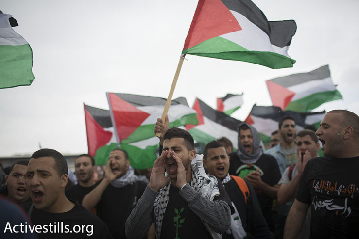 Palestinian youth shout slogans during the March of Return, Hadatha, Lower Galilee, April 23, 2015. (Oren Ziv/Activestills.org)