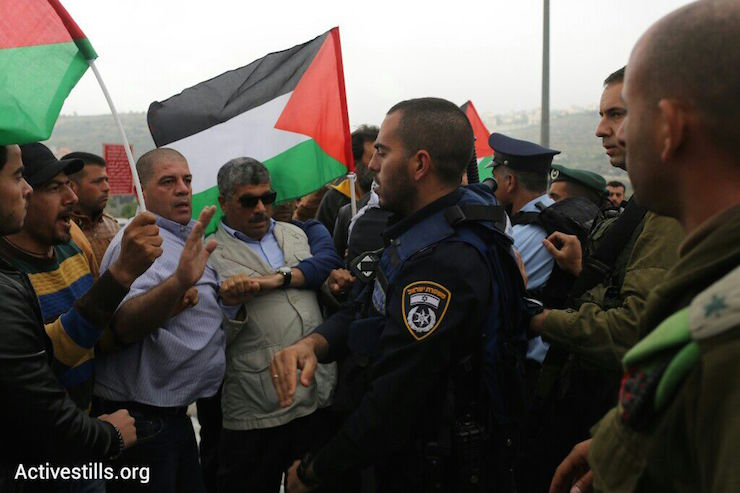 Israeli security forces stop Palestinian protesters from reaching the site of the 'Biblical Marathon,' West Bank, April 9, 2015. (Photo by Oren Ziv/Activestills.org)