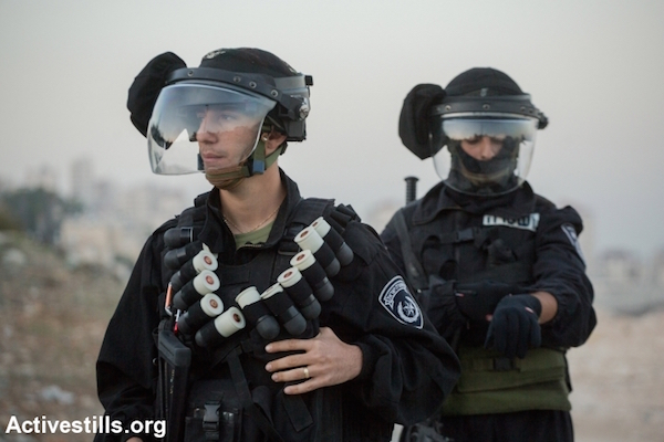 Israeli police with black sponge-tipped bullets in East Jerusalem, November 12, 2014. (Photo: Faiz Abu Rmeleh/Activestills.org)