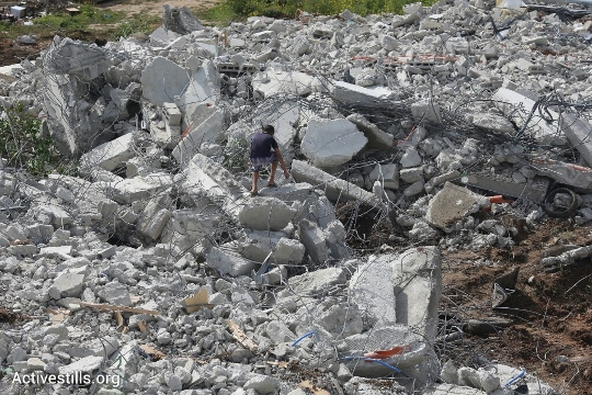 The remains of the demolished buildings in the unrecognized village Dahmash, near Lod, Israel, April 15, 2015. (photo: Oren Ziv/Activestills.org)