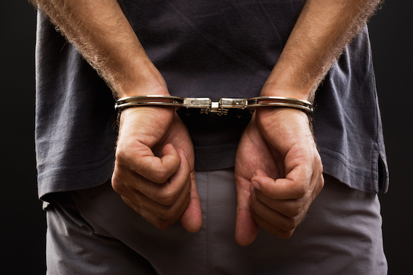Illustrative photo of a man being arrested. (Shutterstock.com)