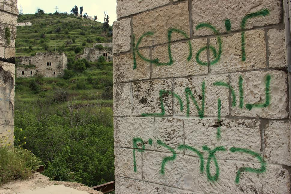 Graffiti seen on a wall in the depopulated Palestinian village Lifta, depopulated Palestinian village of Lifta, located on the edge of West Jerusalem. The graffiti reads: 'Lifta takes revenge on Arabs.' (photo: Natasha Roth)