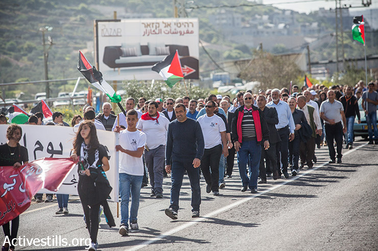 Thousands of people participated in a march commemorating Land Day in the village of Deir Hana in northern Israel, March 30, 2015.   Land Day is held every year to mark the deaths of six Palestinians protesters at the hands of Israeli police and troops during mass demonstrations on March 30, 1976, against plans to confiscate Arab land in Galilee. (photo: Activestills.org)