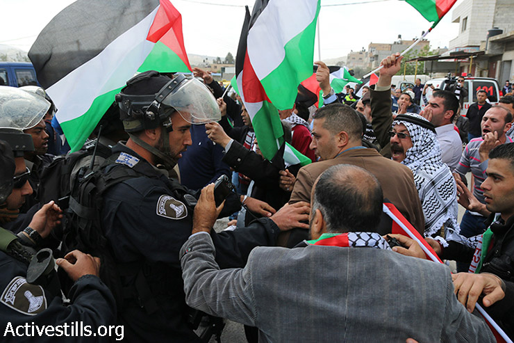 Palestinians demonstrate to mark Land Day in Huwwara village, West Bank, March 30, 2015. At least 15 participants were wounded in clashes. Land Day is held every year to mark the deaths of six Palestinian protesters at the hands of Israeli police and troops during mass demonstrations on March 30, 1976, against plans to confiscate Arab land in Galilee. (photo: Activestills.org)