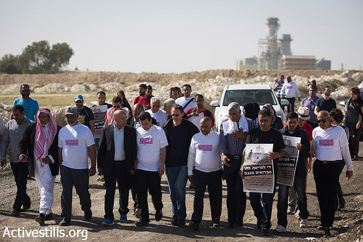 Parliament members, Bedouins and activists march on the road leading from the unrecognised village of Wadi al Na'am to the city of Beer Sheva during a four-day march to Jerusalem calling for the recognition of 46 Bedouin villages in the Negev, Israel, March 26, 2015.  (photo: Activestills.org)