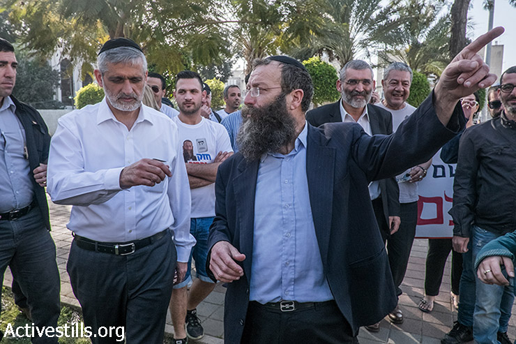 Right-wing politicians Ali Ishay (left) and Baruch Marzel (center) walk through south Tel Aviv's Levinsky Park as part of anti-asylum seeker election campaigning, February 8, 2015. (photo: Activestills.org)