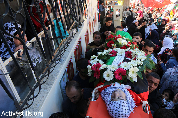Palestinians carry the body of Ali Safi, Jalazun Refugee Camp, West Bank, March 26, 2015. Safi, 20 years of age, was shot with live ammunition by Israeli forces during clashes near the refugee camp on March 18. He was taken to Ramallah hospital, and placed in the ICU until he died on March 25. According to the Palestinian news agency Ma'an, the clashes erupted last week after a protest in opposition to the construction of a wall between the nearby Israeli settlement of Bet El and the refugee camp. (photo: Activestills.org)