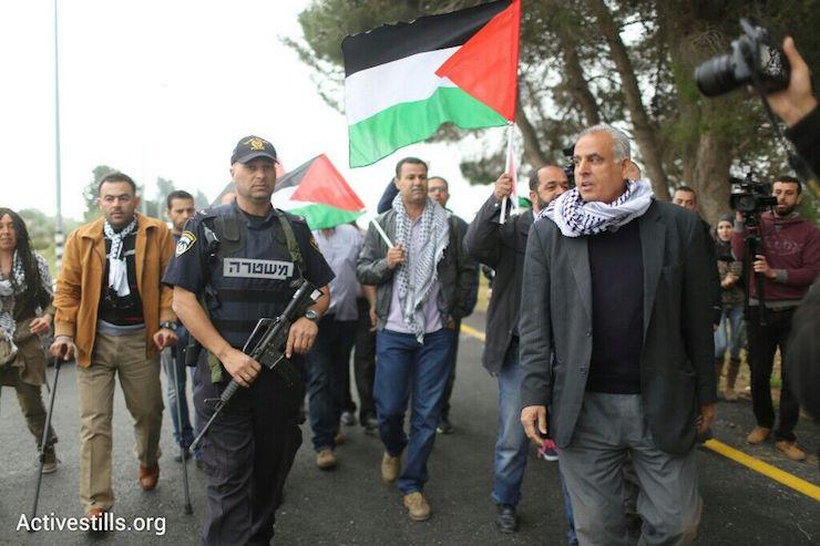 Palestinians protestthe 'Biblical Marathon,' West Bank, April 9, 2015. (Photo by Oren Ziv/Activestills.org)