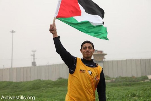 Soccer protest in Gaza (Photo by Anne Paq/Activestills.org)