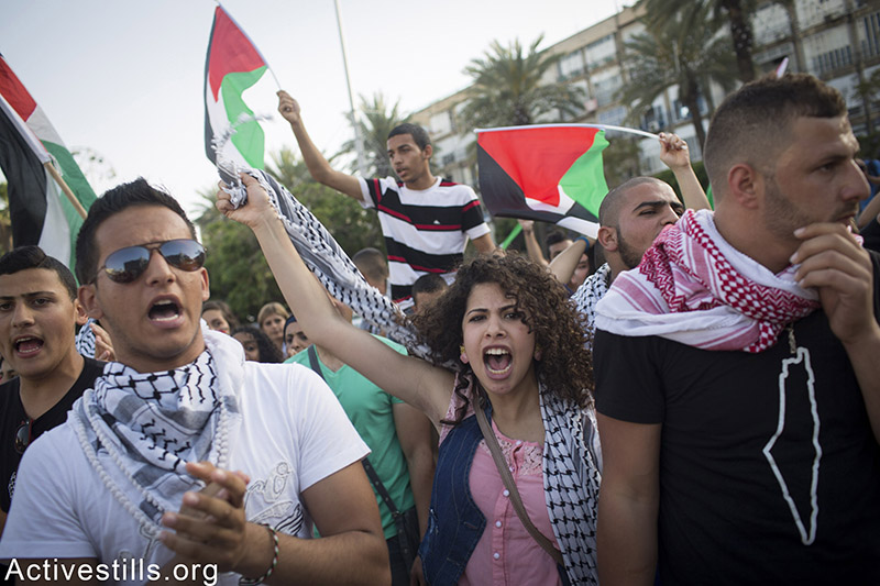 Thousands of Palestinians with Israeli citizenship protest in centre Tel Aviv against home demolitions, April 28, 2015. One day strike was held in the Palestinian villages and towns inside Israel to protest recent demolitions by the Israeli authorities. Oren Ziv / Activestills.org