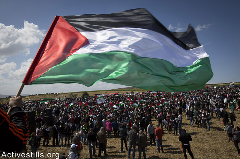 Thousands of Palestinian citizens of Israel, march the March of Return on the lands of the destroyed village of Hadatha, near Tiberias, April 23, 2015. 'March of the Return' is held every year since 1998 on Israel's Independence Day to highlight the memory of the Nakba (disaster) of the Palestinian people and to advocate for the right of the Palestinian refugees and IDPs of 1948 displacement to return to their homes. Akram Drawshi / Activestills.org