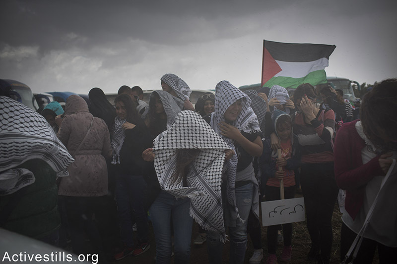 Thousands of Palestinian citizens of Israel, march the March of Return on the lands of the destroyed village of Hadatha, near Tiberias, April 23, 2015. 'March of the Return' is held every year since 1998 on Israel's Independence Day to highlight the memory of the Nakba (disaster) of the Palestinian people and to advocate for the right of the Palestinian refugees and IDPs of 1948 displacement to return to their homes. Oren Ziv / Activestills.org