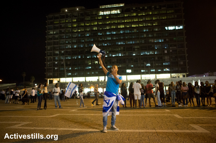 Ethiopian Israelis shout slogans in Rabin Square in center Tel Aviv during a protest against police brutality and racism, May 18, 2015.
