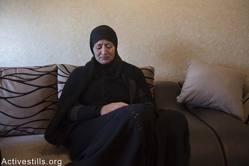The mother of Palestinian teenager Ali Said Abu Ranam, in his house in East Jerusalem, April 25, 2015. Police said Abu Ranam, 17-year-old east Jerusalem resident, approached a checkpoint early Saturday with a butcher's knife and tried to attack soldiers who shot him dead. Faiz Abu-Rmeleh / Activestills.org