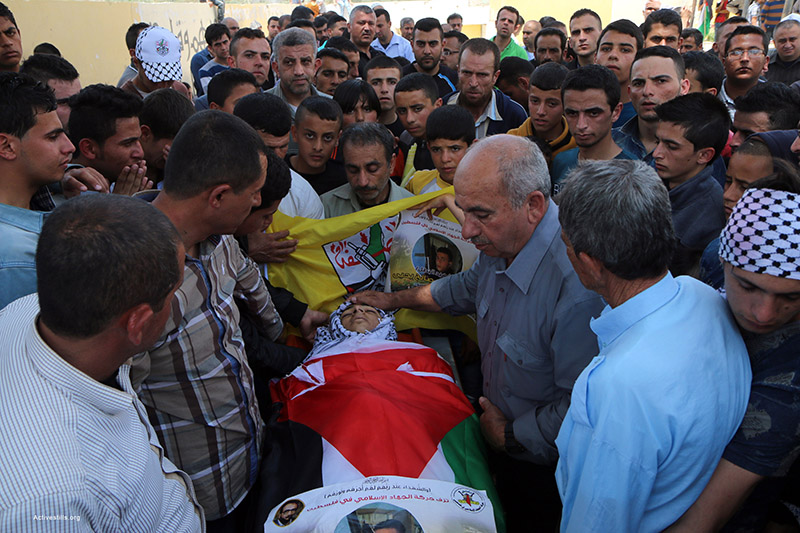 Palestinians mourn during the funeral of Muhammad Yahiya, 18, in Al 'Araqa village near the city of Jenin, West Bank, April 28, 2015. Yahiya was shot by Israeli forces late Monday. According to his Father, Yahiya was walking with his friends nearby the Separation Wall after a family wedding when Israeli soldiers opened fire and hit him. Ahmad al-Bazz / Activestills.org