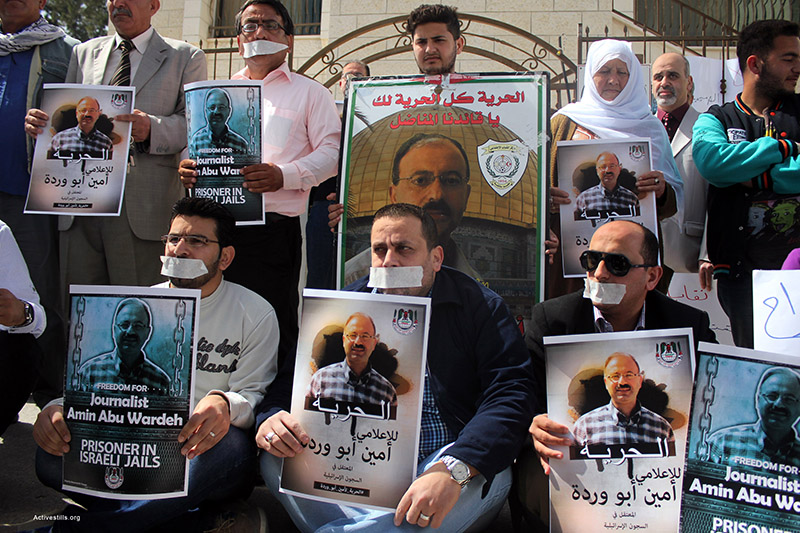 Palestinian journalists and activists protest in front of the Rec Cross offices in the city of Nablus, against Israeli administrative detention of the Palestinian journalist Amin Abu Wardeh, Nablus, West Bank, April 21, 2015. Amin was one of 27 Palestinian civilians who were arrested by Israeli forces at the early morning of April 15, 2015. According to the Israeli administrative detention law, Israel can hold prisoners without charge or trial for unlimited period of time. Ahmad al-Bazz / Activestills.org
